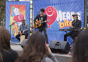A photo of the band Parachute performing in Malcolm X Plaza.