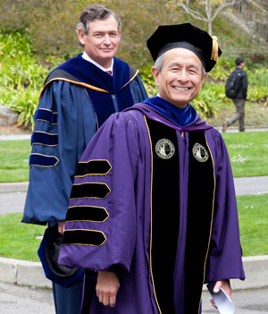A photo of SF State President Leslie E. Wong walking in the investiture process, followed by CSU Chancellor Timothy P. White