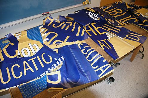 A photo of garments made from old SF State banners lying on a worktable.