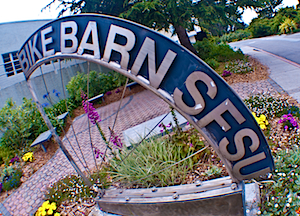 Photo of the sign for SF State's bicycle parking garage, the Bike Barn.