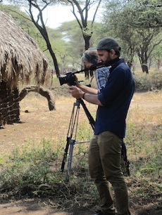 A photo of SF State students Kellen Balla, foreground, and James Baumann, filming during the Electronic Media and Social Justice class's trip to Tanzania to make films for nongovernmental organizations.