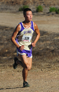 A photo of SF State cross-country team member Ryan Chio running during the Crystal Springs Invitational in Belmont.
