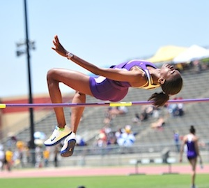 Photo of Tiana Wills high-jumping at the Washington Husky Classic