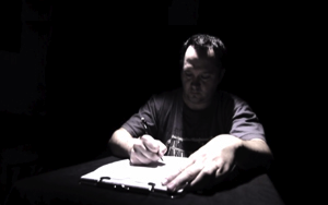 A screenshot of Bobby Hollingsworth at a desk, from his Veteran Documentary Corps film.