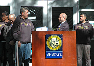 A photo of Alex Lazar, a representative from House Democratic Leader Nancy Pelosi's office, presenting the 2013 Nancy Pelosi Scholarship to VETS@SFSU President Ben Yang.