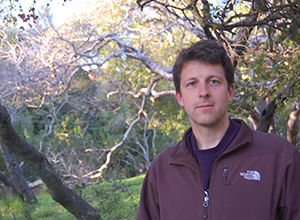 A photo of SF State Assistant Professor of Earth & Climate Sciences Alexander Stine.