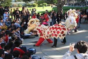 A photo of students performing a traditional Chinese dragon dance during International Education Week 2012.