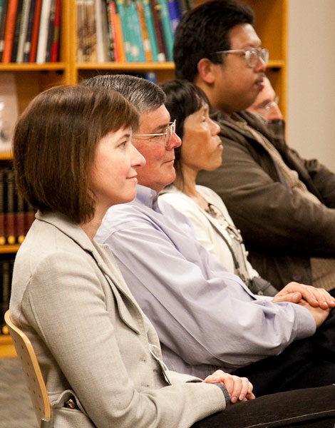 A photo of audience members listening to Kevin Starr's lecture on the Sutro Library