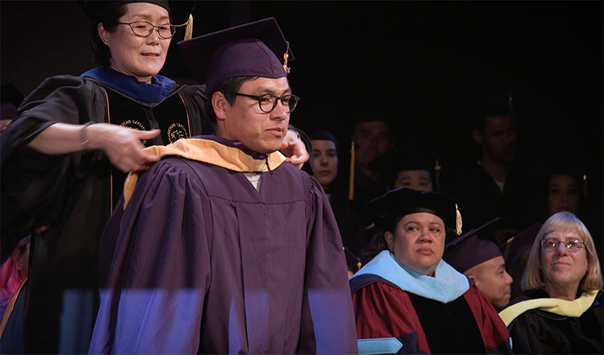 David receives his master's degree in molecular biology from SF State's College of Science and Engineering during the Commencement ceremony in May 2017.